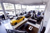 yellow M4 coupe in Marshall BMW showroom